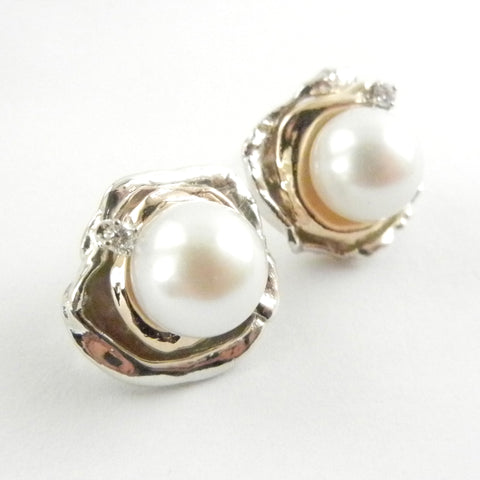 Custom design 14K gold and silver earrings with white pearls and diamonds.
