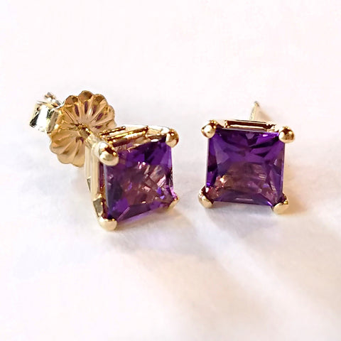 Elevate your outfit with these gold stud earrings custom made with princess cut amethyst and 14 kt yellow gold.
