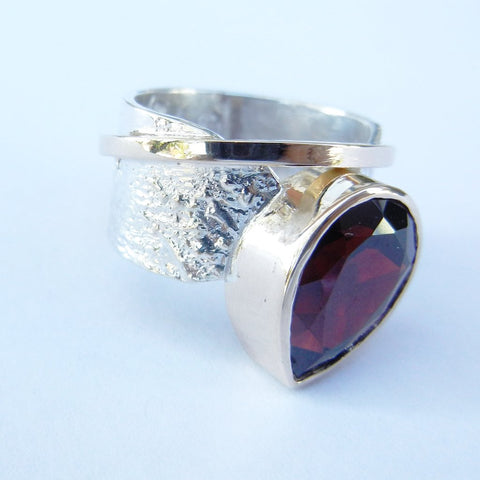 Pear Garnet Set in a Reticulated Silver Band