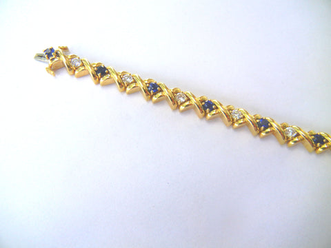 Gold Bracelet with Diamonds and Sapphires