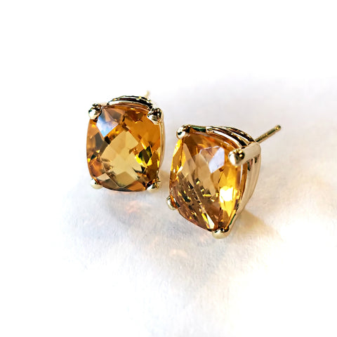Cushion cut citrine sparkles like sunshine set in gold stud earrings for a special custom deisgn.