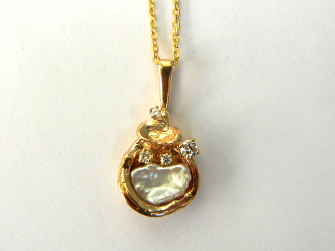 Fancy Pearl in 14K Gold with Diamond accents.