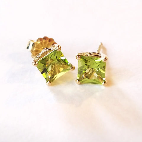 Elevate your outfit with these gold stud earrings custom made with princess cut peridot and 14 kt yellow gold.
