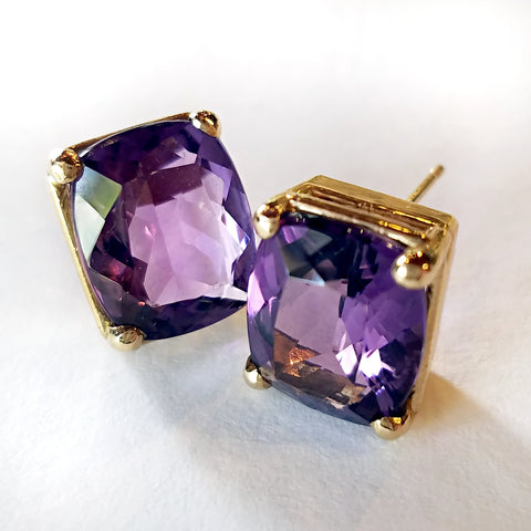Breathe new life into your unique style with custom made gold stud earrings set with cushion cut amethyst.
