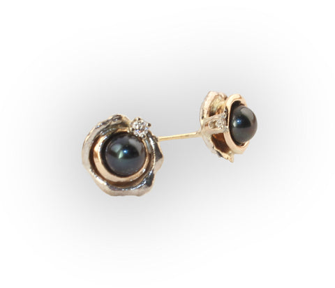 Silver and gold stud earrings with Tahitian pearls like a night sky with twinkling diamonds.