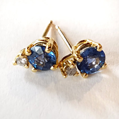 Indulgent round sapphires with diamond accents set in custom design gold stud earrings.