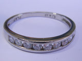 Platinum Band with 9 channel set diamonds