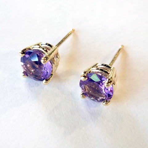 Add an elegant touch with these custom design gold stud earrings set with round amethyst stones.