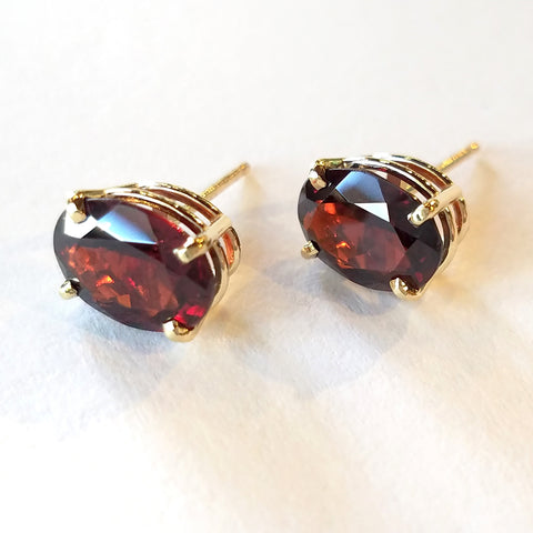 Oval garnets set in custom made gold stud earrings.