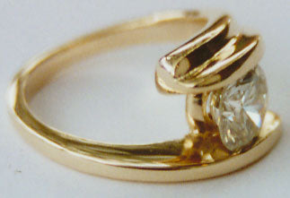 Diamond Solitaire bezel set in a Bypass Setting