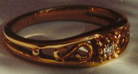 Gold Filigree band with a Diamond Center
