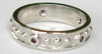 14kt white gold band with bezel set Rubies