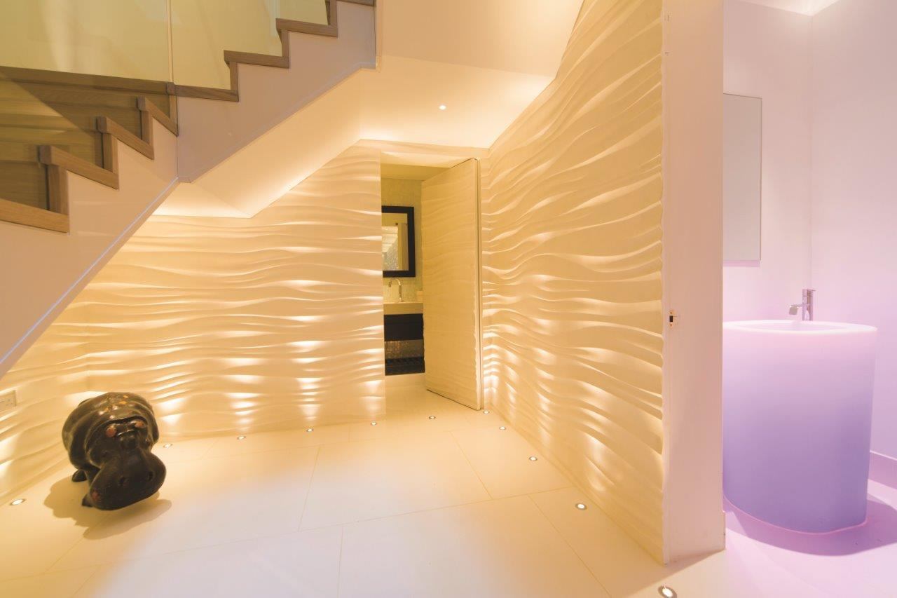 Staircase and bathroom with coloured lighting