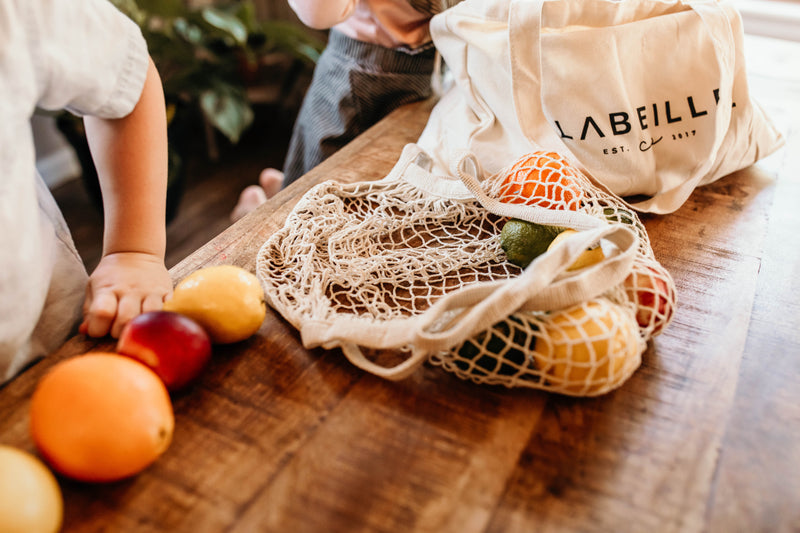 lemons and fruit in a beige parisian net market bag by labeille co