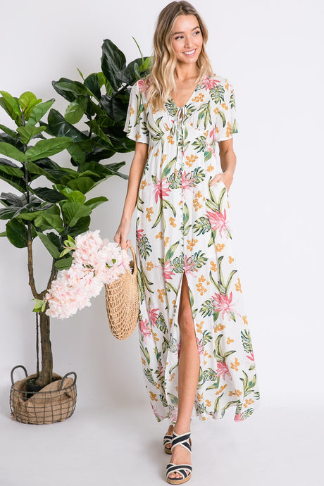 BOHO TROPICAL BOTANICAL FLORAL AND LEAF PRINT RIBBON TIE V-NECK BUTTON DOWN SLIT HEM SHORT FLUTTER SLEEVE MAXI DRESS.