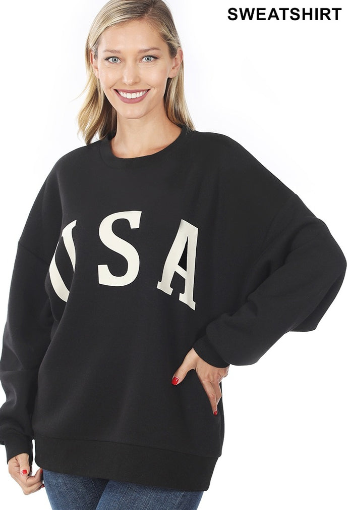 black crewneck sweatshirt with ivory U S A printed on the front. Ribbed neckline, cuffs and band. Super soft.