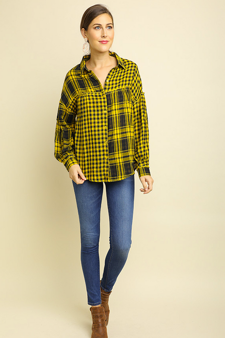 The Beth is a classic button down top with yellow and black plaid and checkered print. Long sleeve, drop shoulder, button up also features a scoop hem. Enjoy the Beth this season! Fabric Contents: 100% Cotton