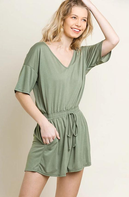 sage green romper with elastic waist and pockets