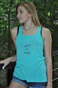 "Teal, flowy racer back tank with ""beyond our Galaxy"" printed on front and stars and crosses floating around it."