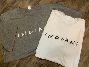 Short Sleeve Friends Themed shirt printed with word Indiana across front chest area. Available in Heather Grey or White. Super soft and trendy.