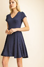 Navy dress with v-neck and white bows. Darts in bodice