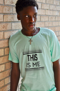 "Mint color Tee shirt with the words ""This is Me"" printed on the front with gradient straight lines both above and below."