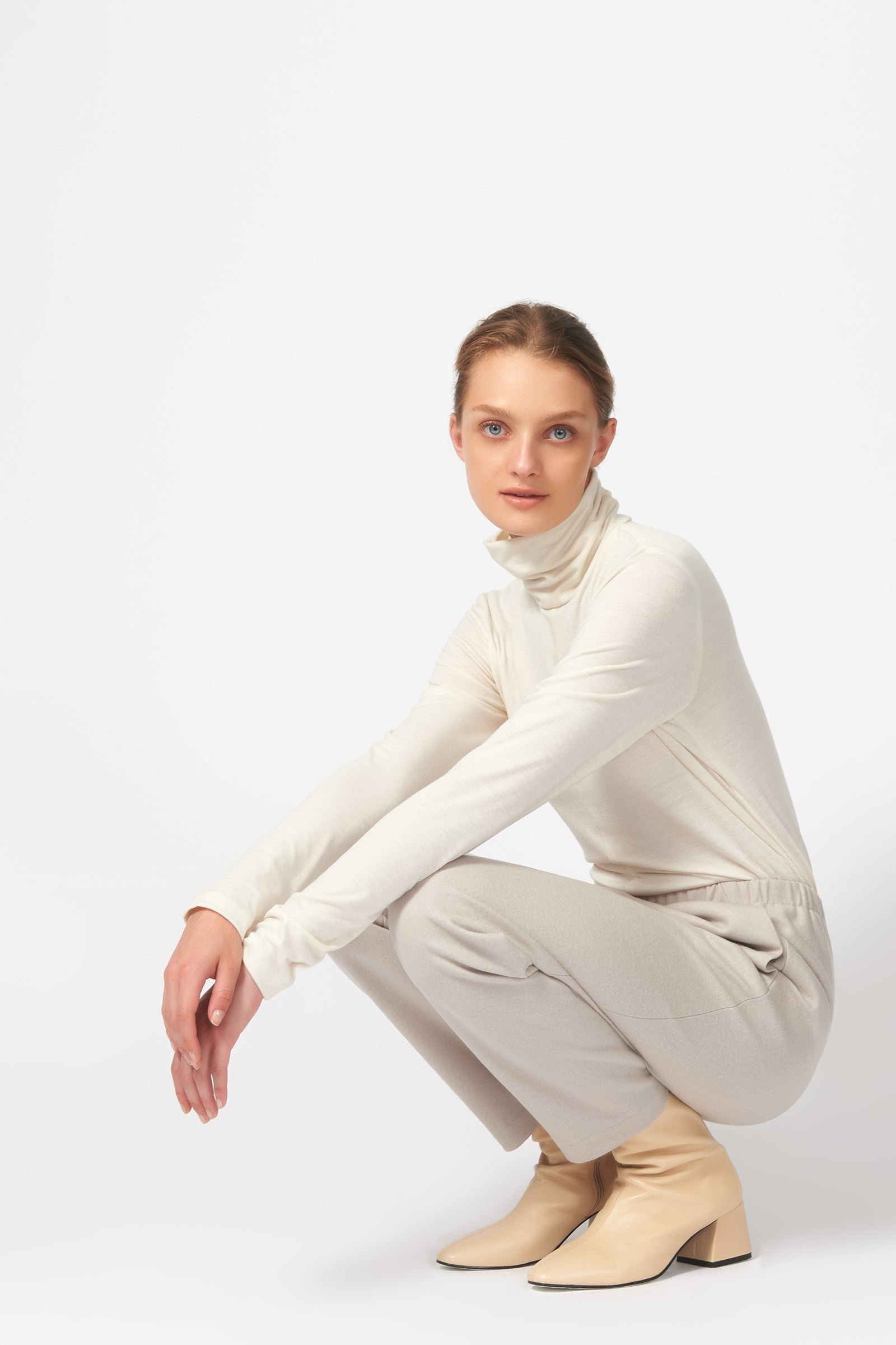 Kal Rieman Felted Jersey Angle Seam Jogger in Mink on Model Crouching Down