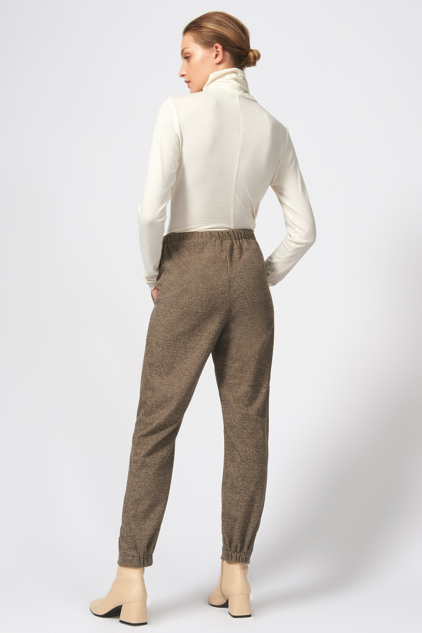 Kal Rieman Angle Seam Jogger in Taupe Herringbone on Model Full Back View