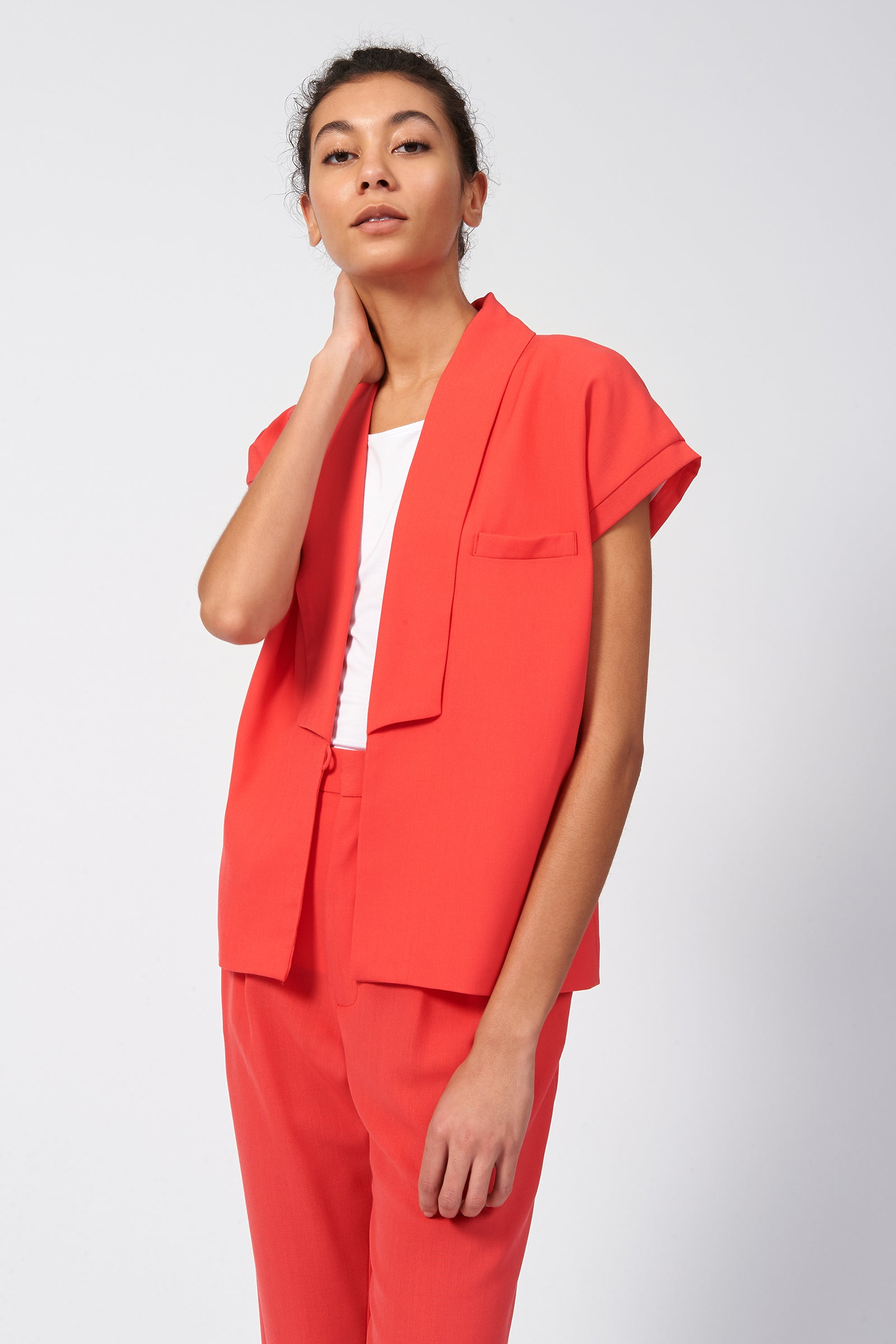 Kal Rieman Cap Sleeve Tux Vest in Coral on Model Front