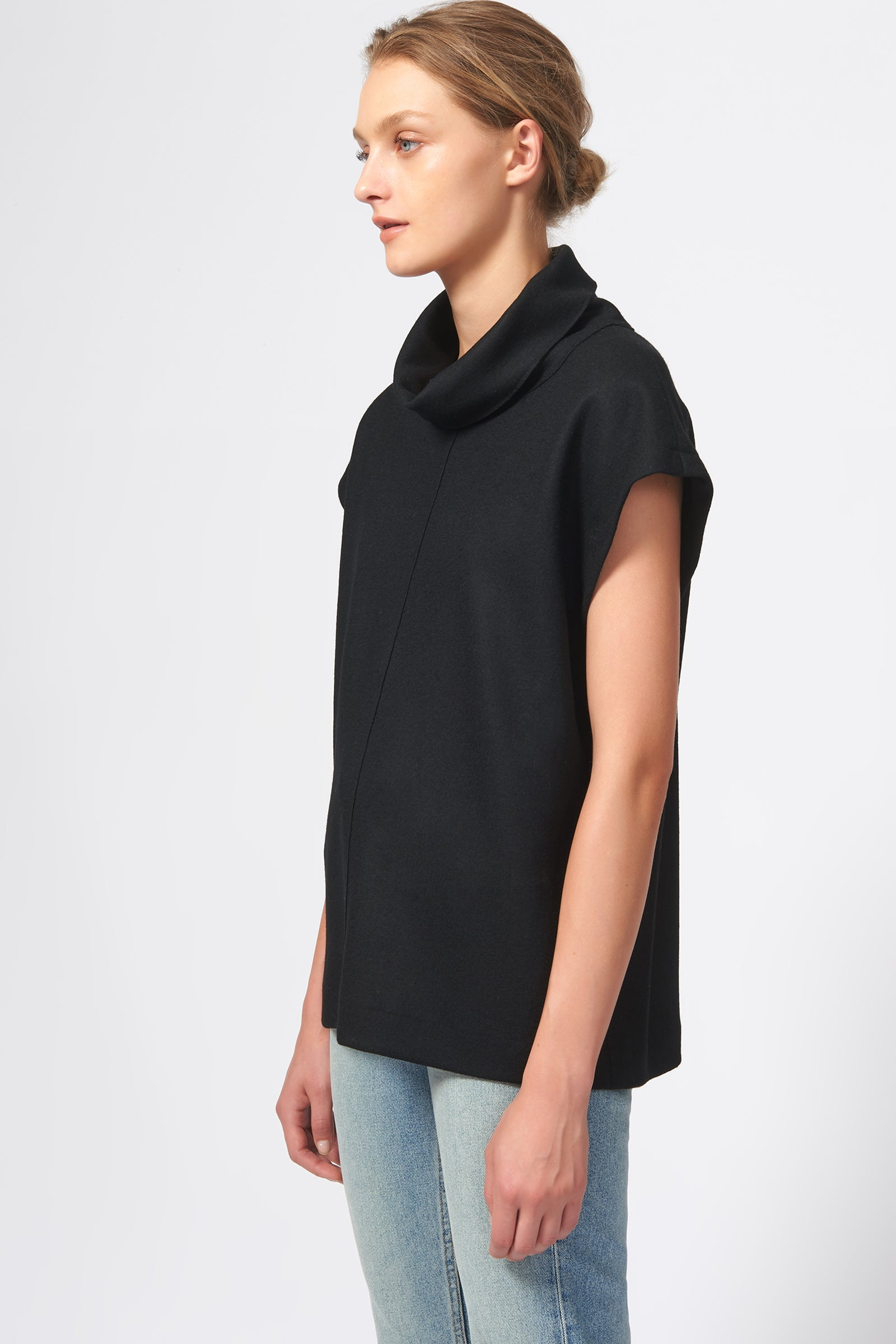 Kal Rieman Seamed Cap Sleeve Turtleneck in Black on Model Side View
