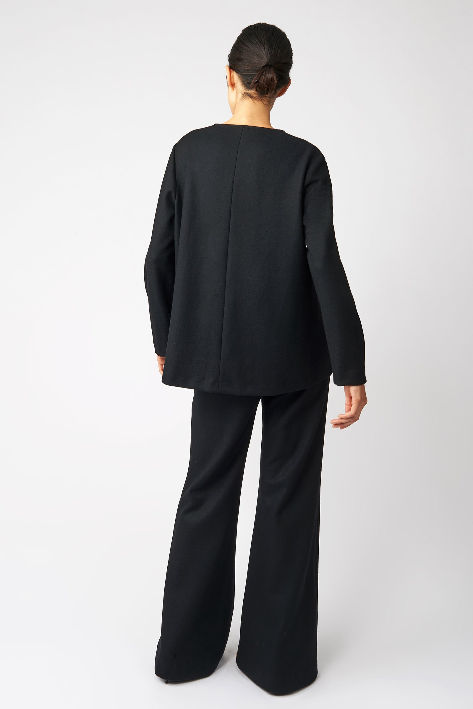 Kal Rieman V Neck Swing Top in Black on Model Back View