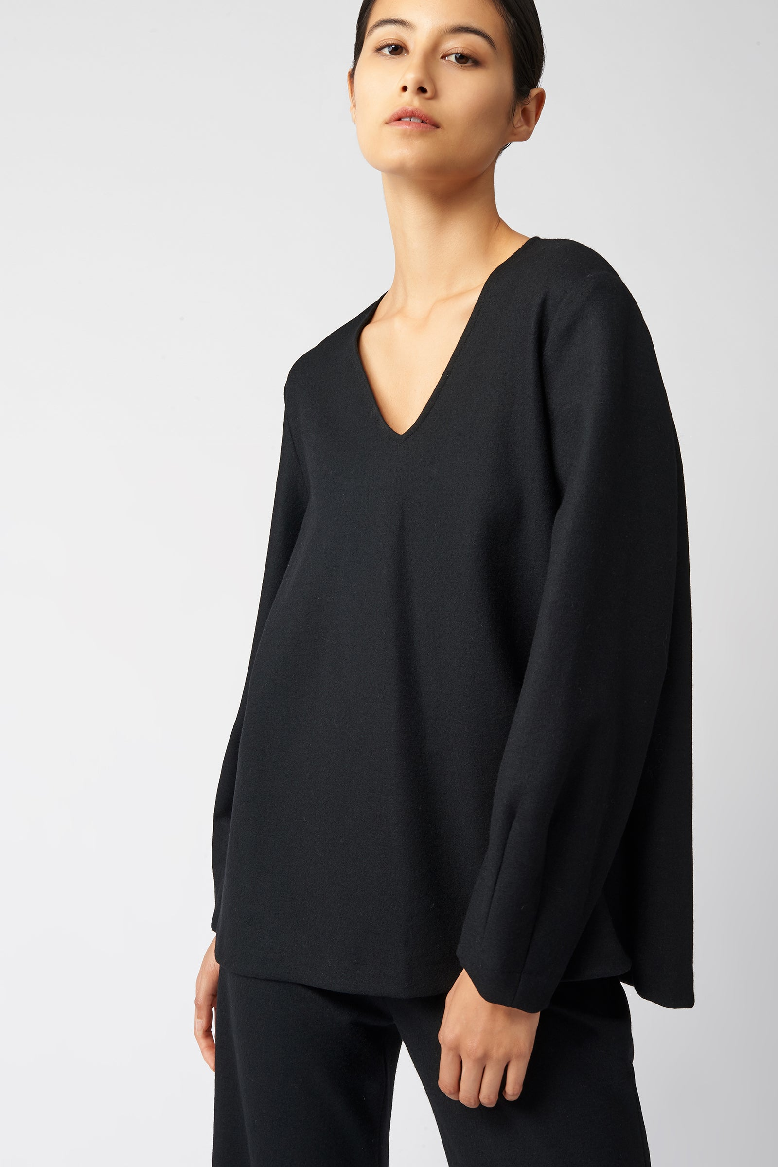 Kal Rieman V Neck Swing Top in Black on Model Front View