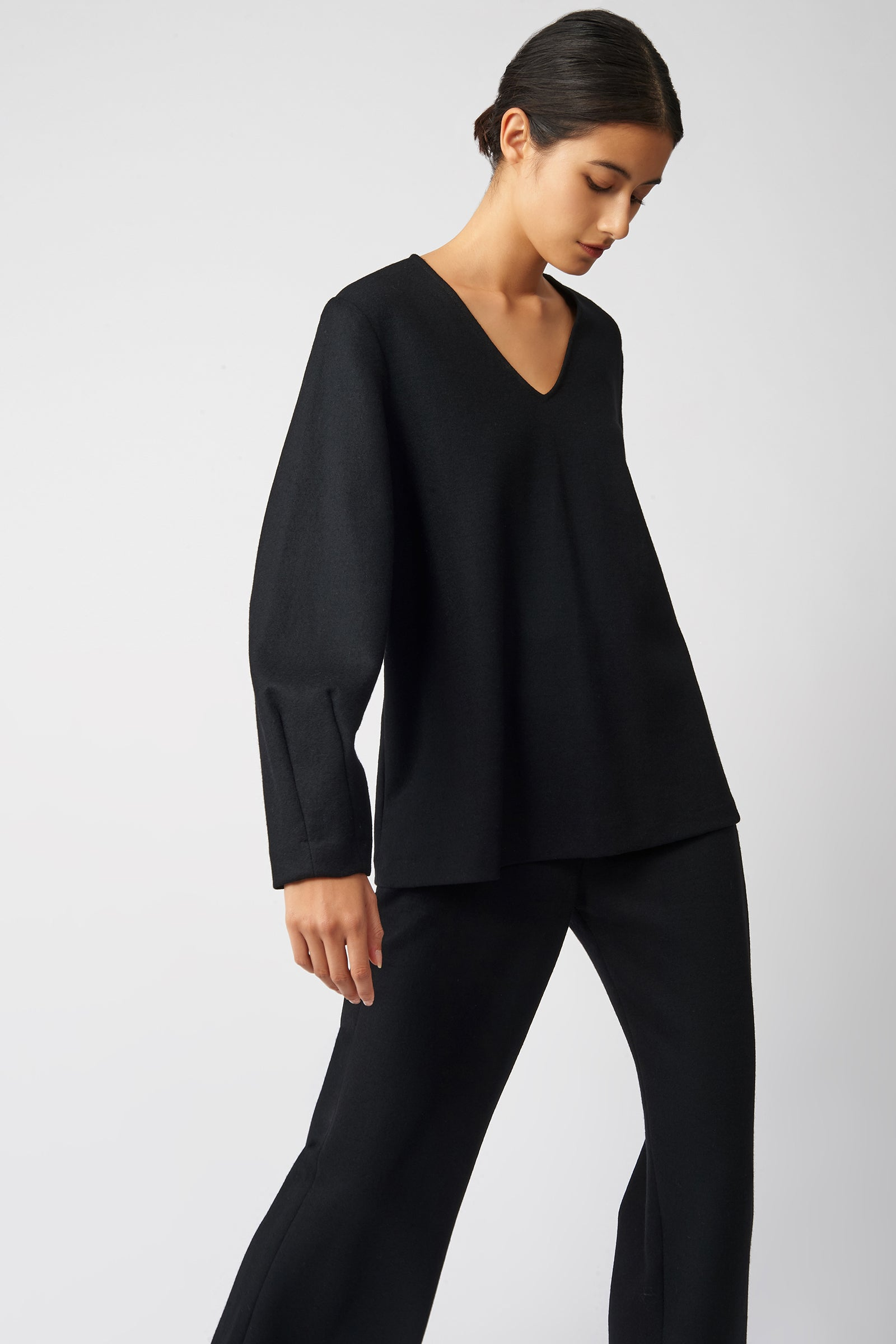 Kal Rieman V Neck Swing Top in Black on Model Side View