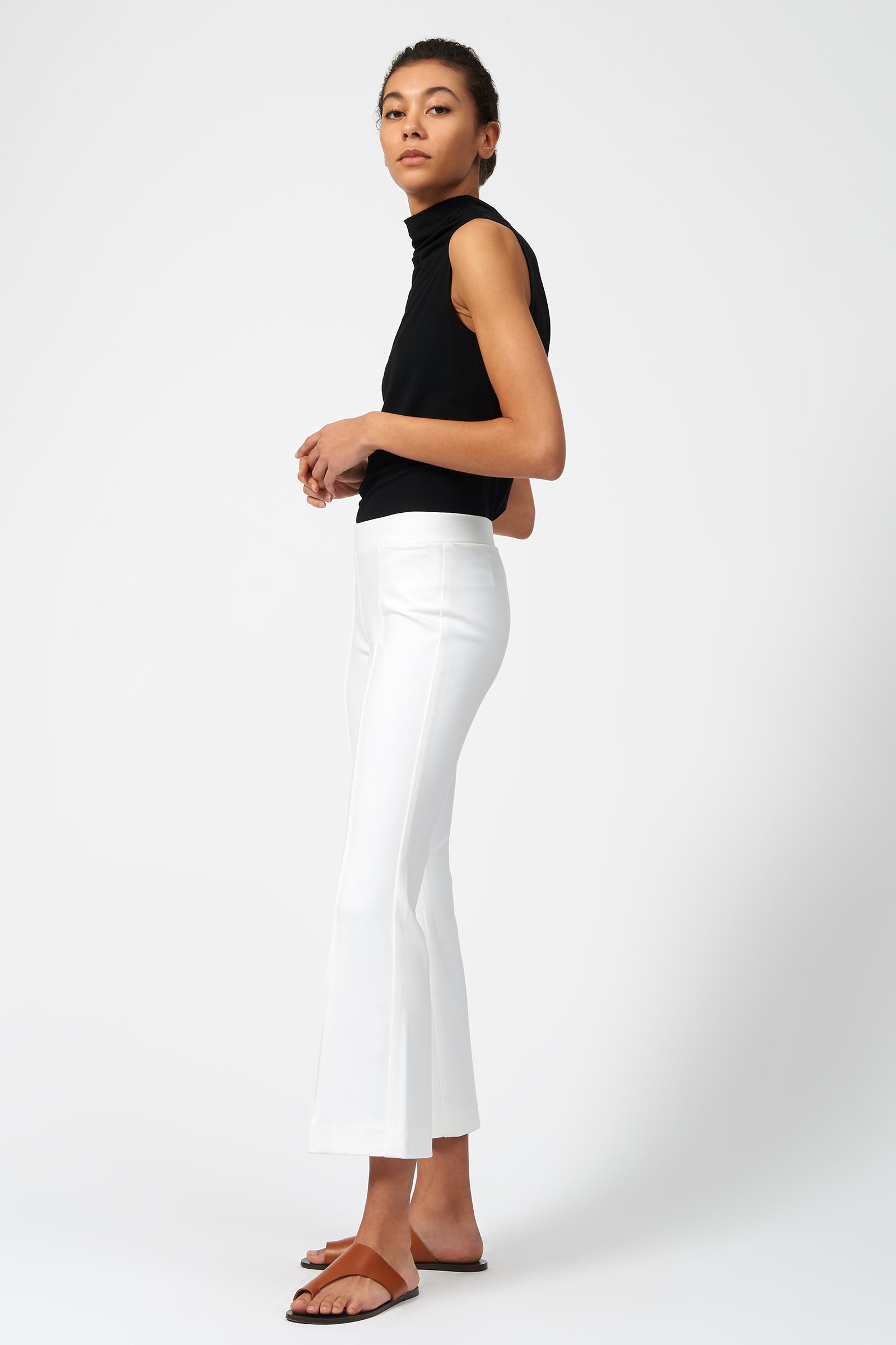 Kal Rieman Pintuck Ponte Crop Flare Pant in White on Model Full Side View