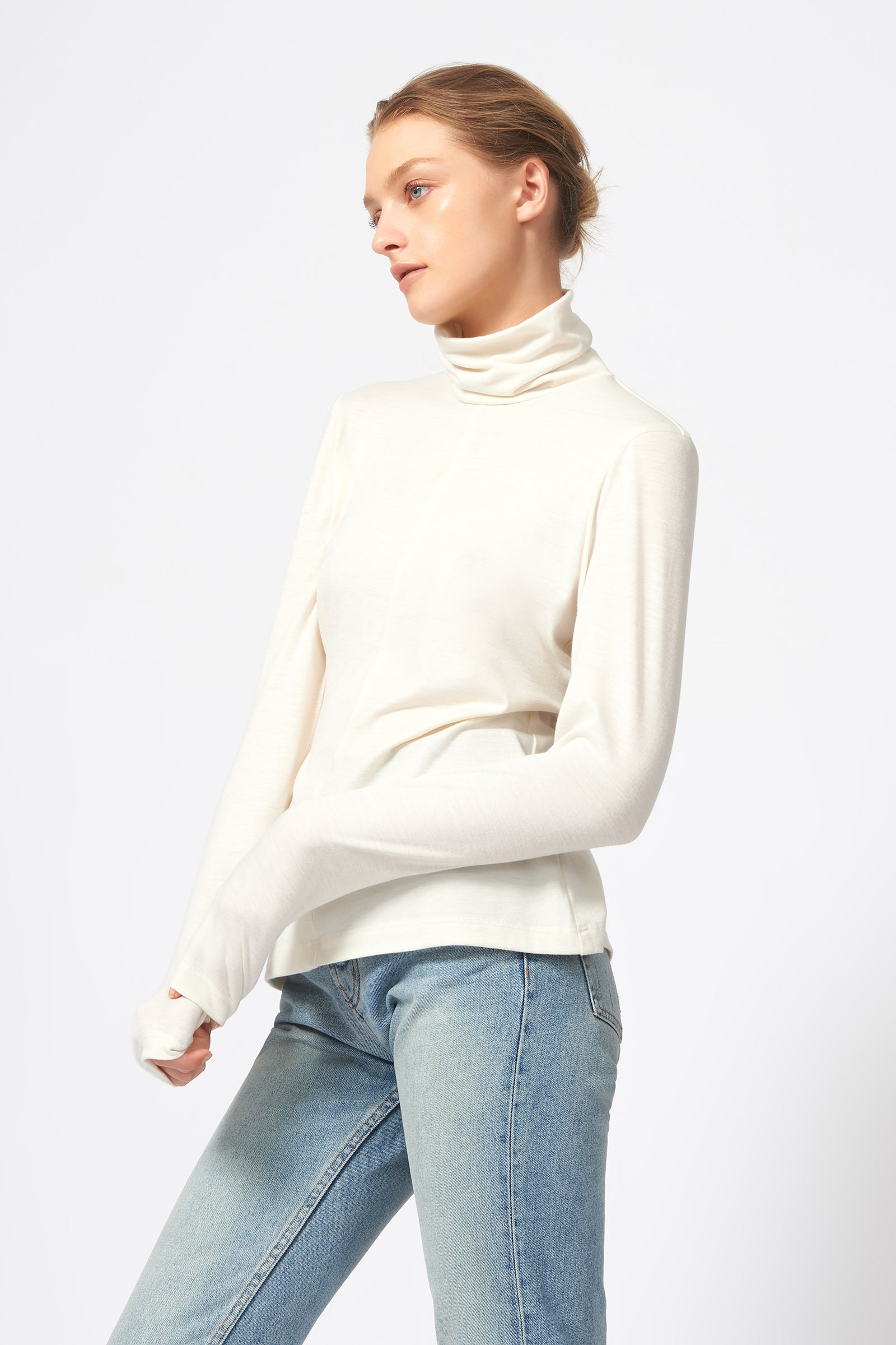 Kal Rieman Seamed Turtleneck in Ivory on Model Side View