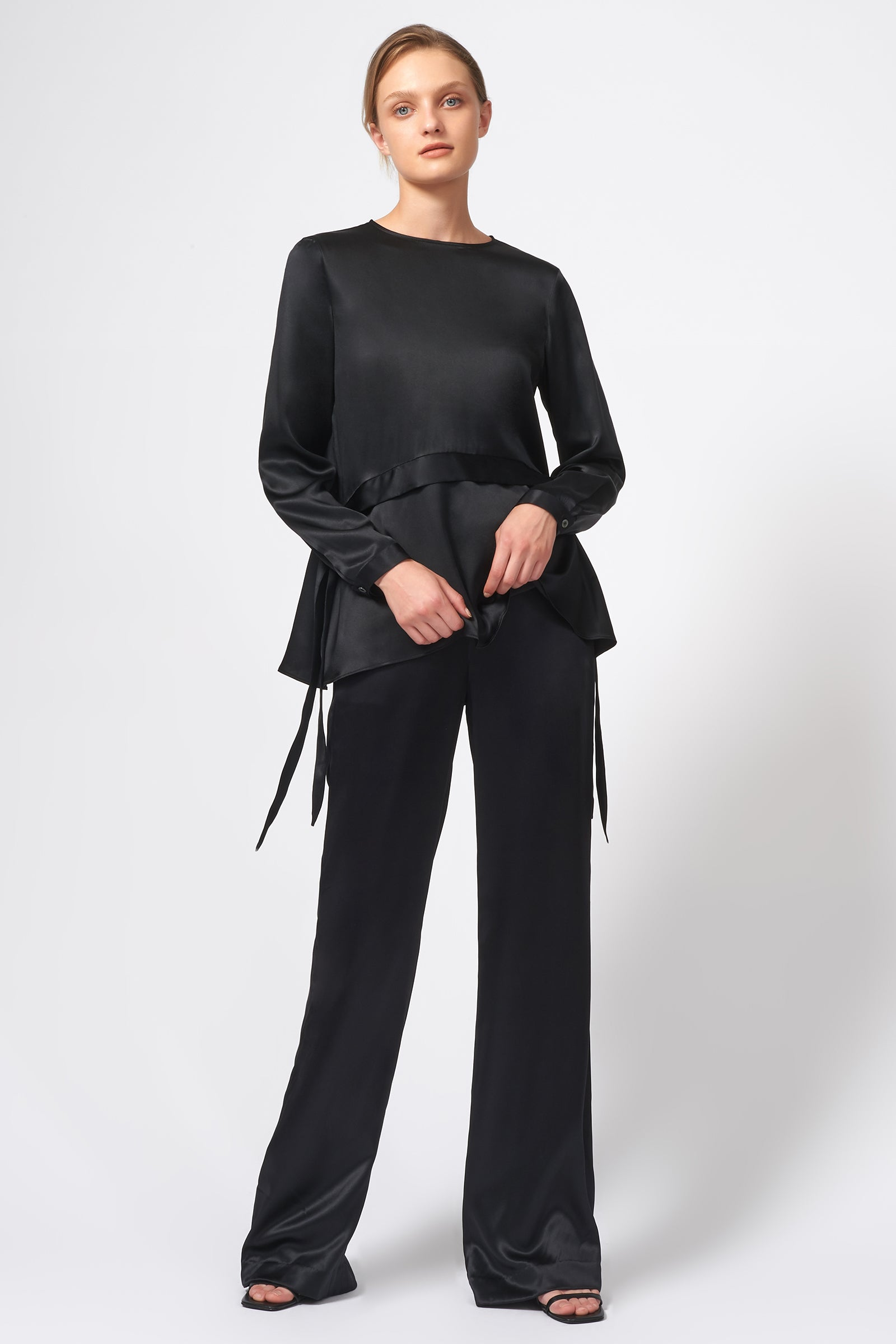 Kal Rieman Side Tie Peplum Blouse in Black on Model Front Full View