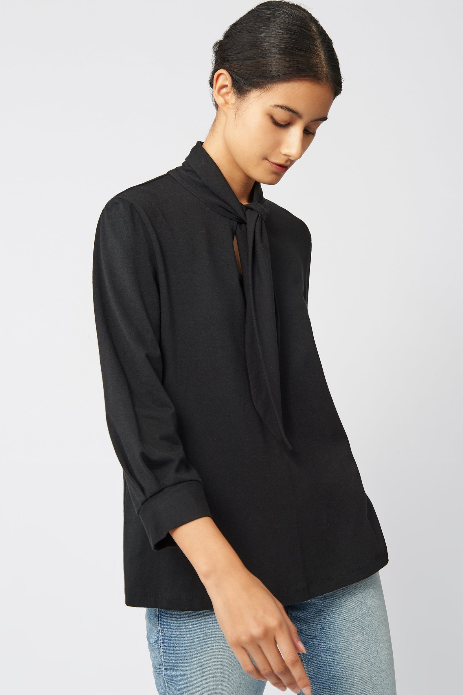 Kal Rieman Tie Neck Top in Black on Model Front Side View