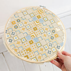 Aurifil artisan Cross stitch in hoop by Lucy Engels