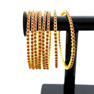 8 Pcs Gold Plated Bangal with Engraved Red Stones