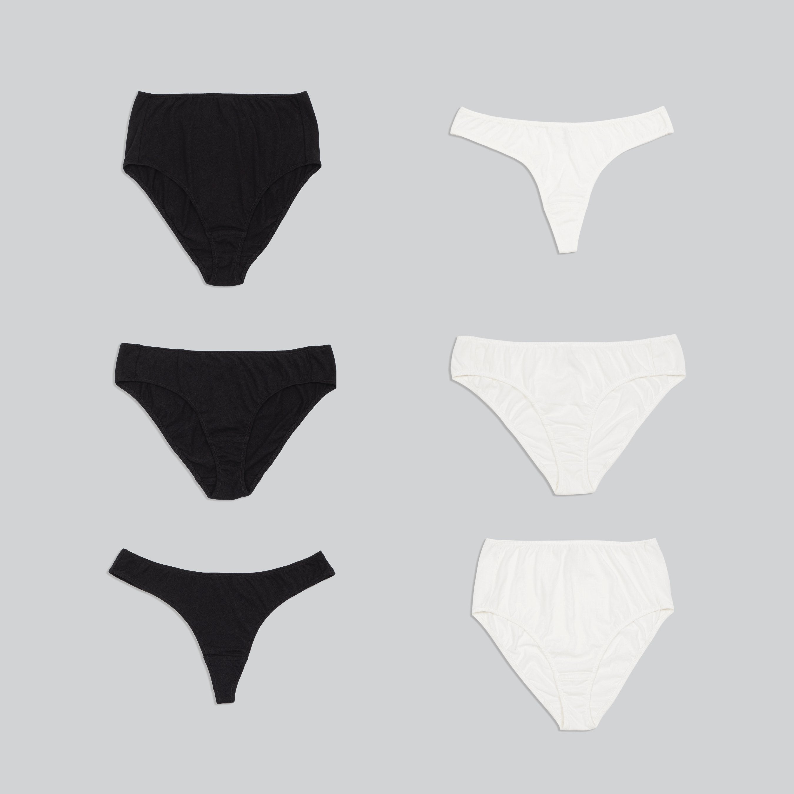 three styles of organic cotton underwear, high rise, bikini and thong in two colors - black and white