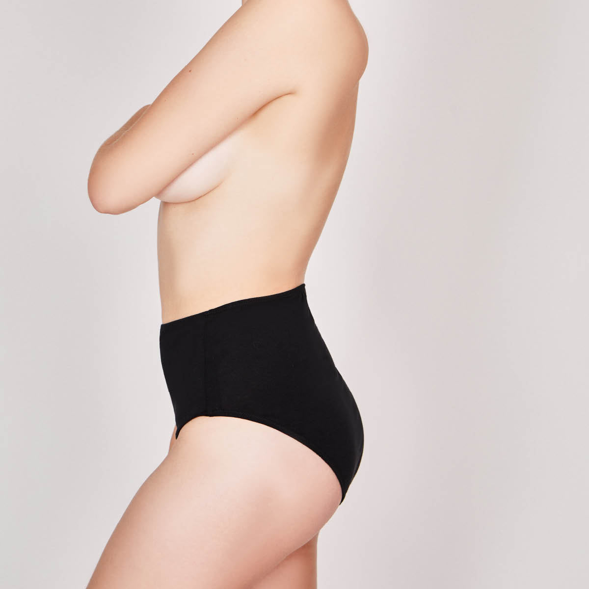 woman wearing high waisted black cotton underwear