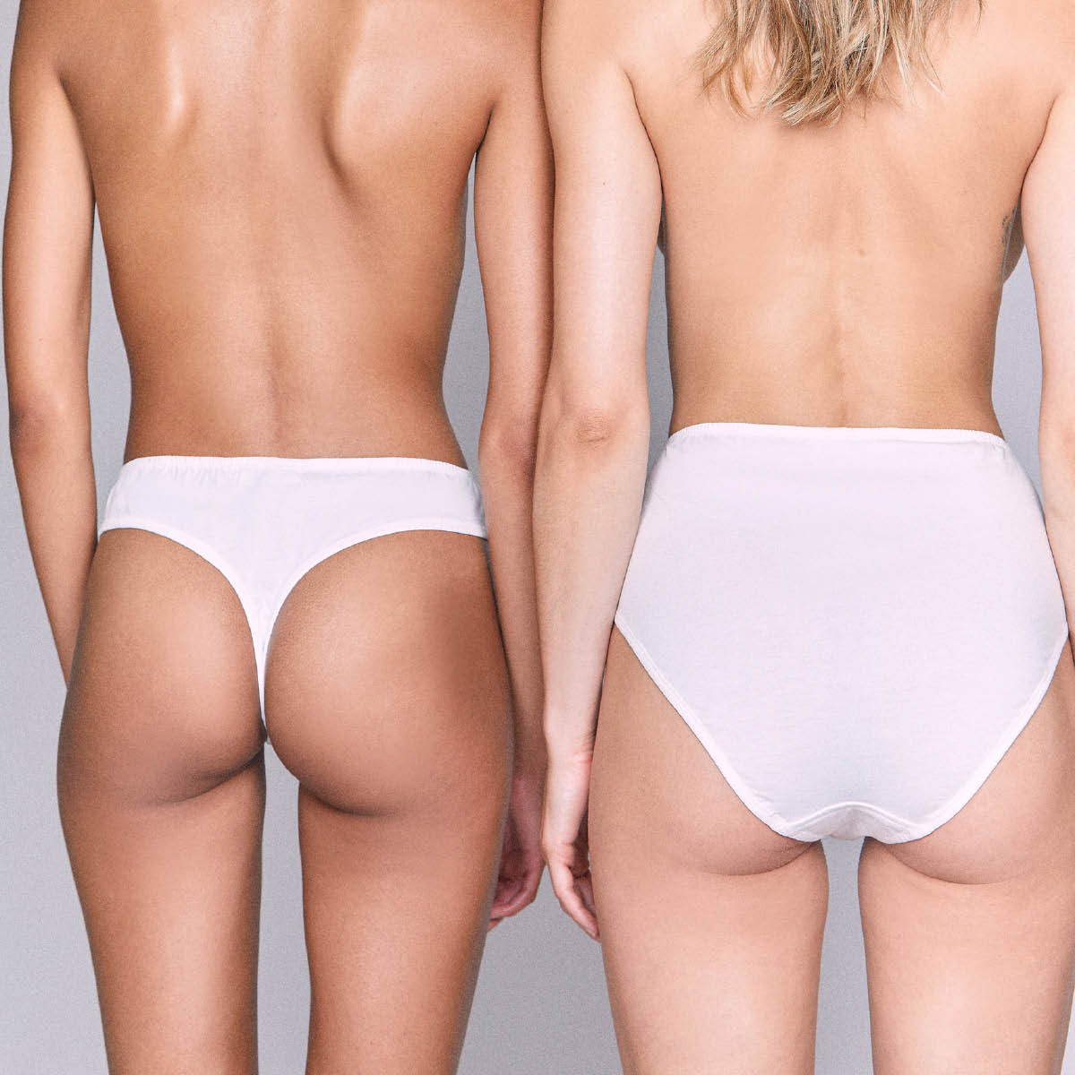two women wearing white organic cotton underwear, one white cotton thong, one high waisted high rise white cotton underwear