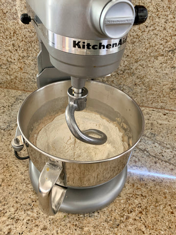 Using a dough hook attachment to mix challah dough