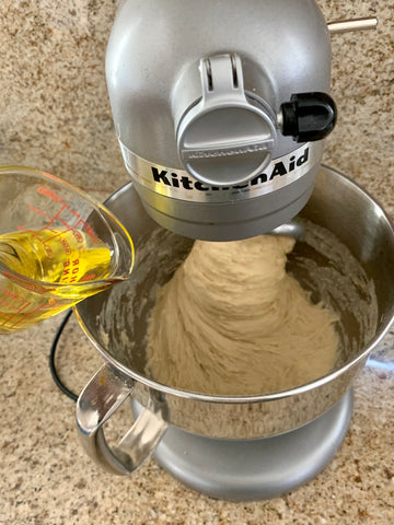 adding oil to the challah dough