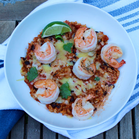 mexican brown rice bowl with black beans, shrimp, and cilantro