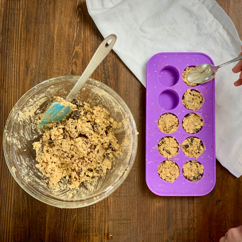 placing cookie dough in the cookie tray by souper cubes with a spoon