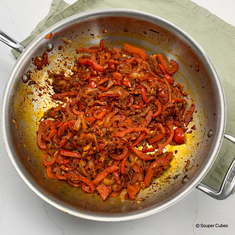 image of sauteed onions and peppers with spices and paprika for shakshuka