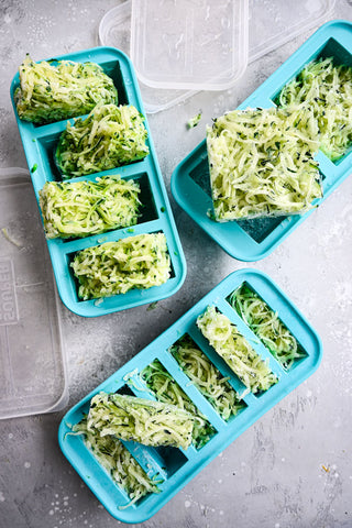 shredded zucchini in all 3 sizes of Souper Cube trays