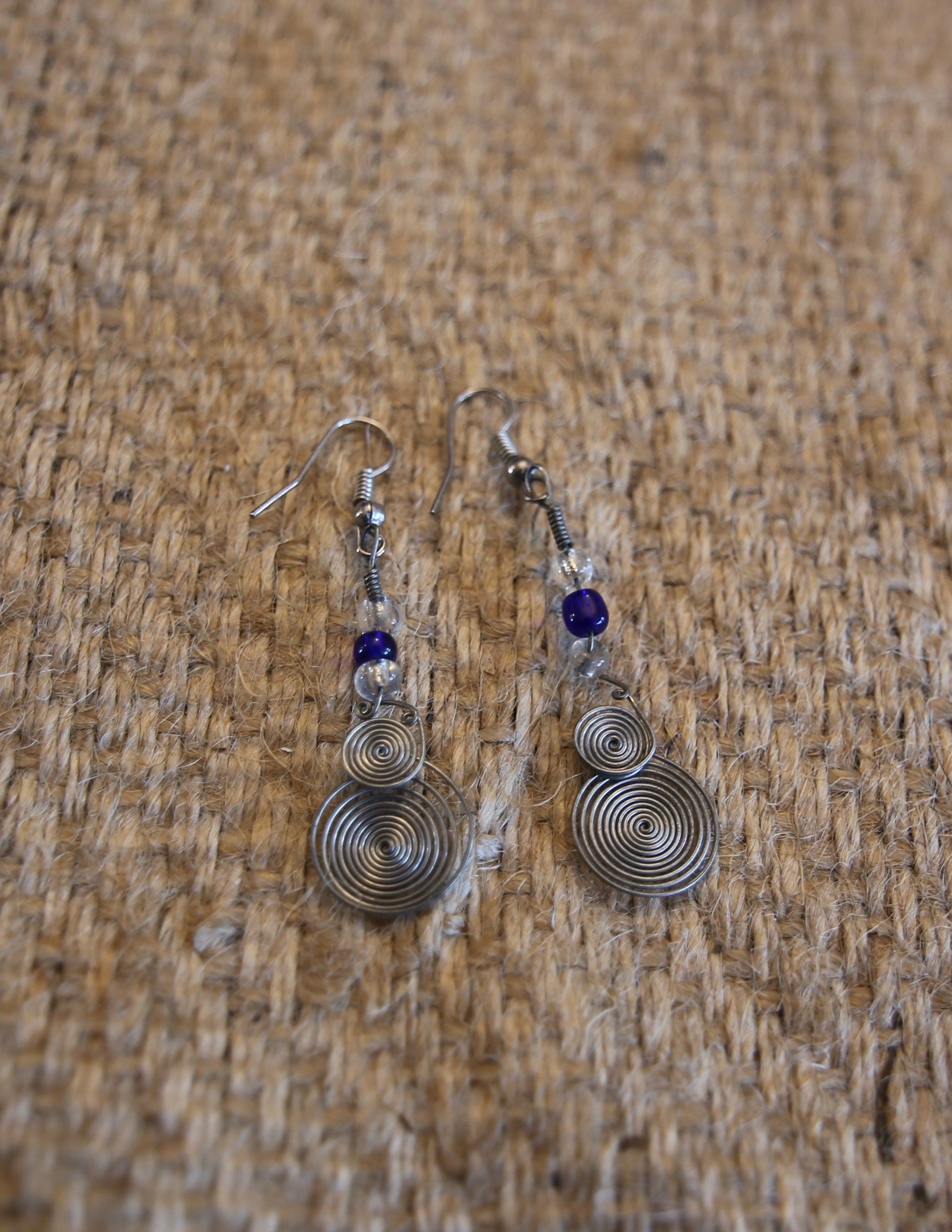 Hand wound metal ear rings with beads