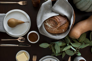 Simple, clean table setting using linen napkin in bread basket